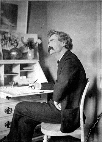 343px-Mark_Twain_pondering_at_desk